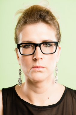 serious woman portrait real high definition green backgro