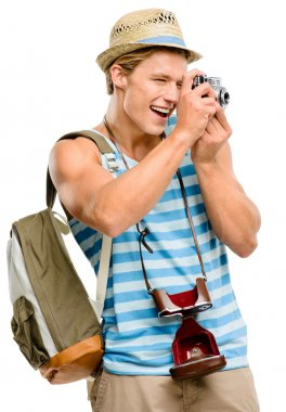 Happy tourist man photographing vintage camera isolated on white