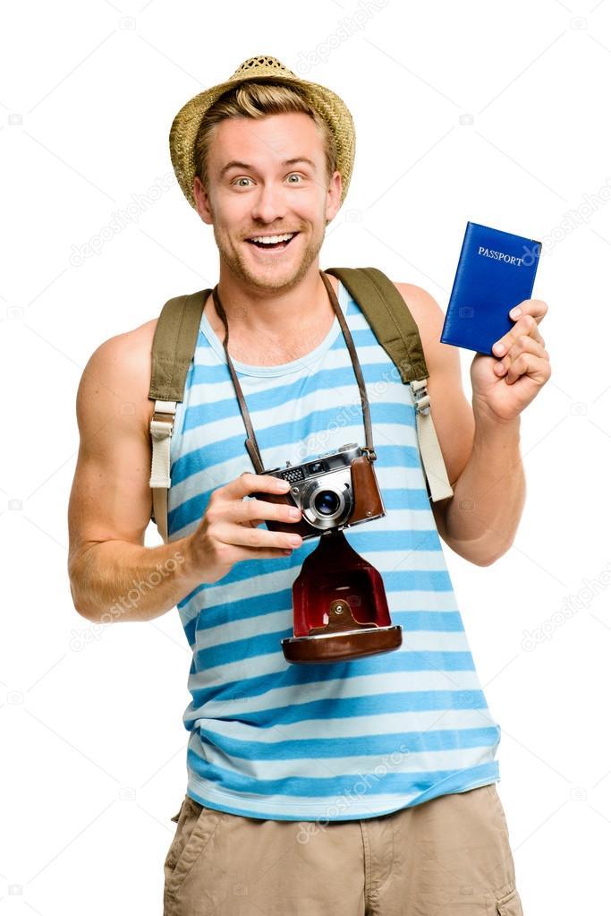 Happy tourist holding passport retro camera isolated on white