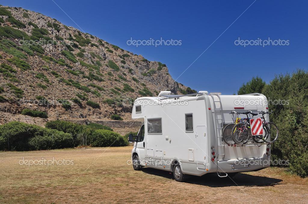 Camper parked in Cala Domestica, Sardinia, Italy