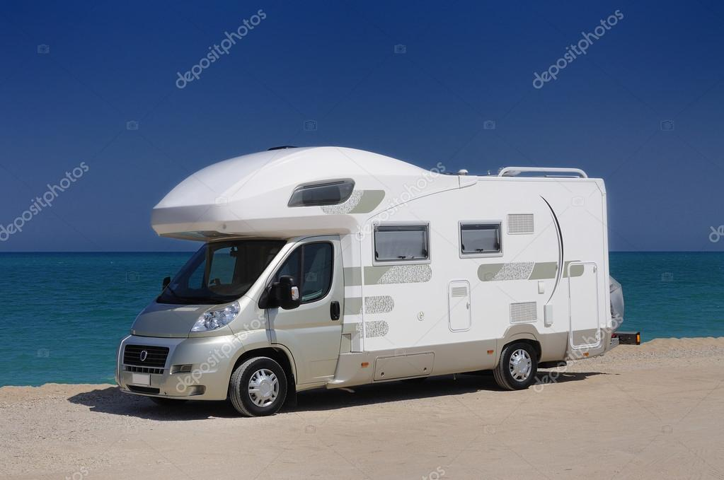 Camper parked on the beach