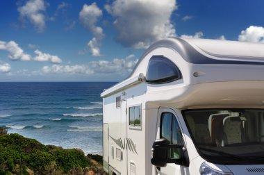 Camper parked on the beach at Buggerru, Sardinia, Italy