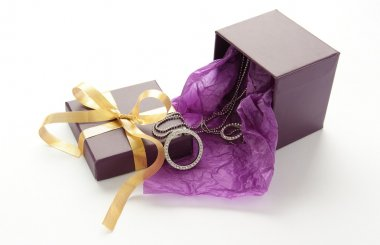 Purple gift box with jewelry