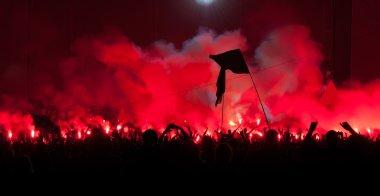 Fans burn flares at rock concert