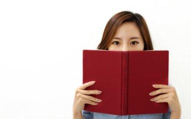 Beautiful asian woman reading a book
