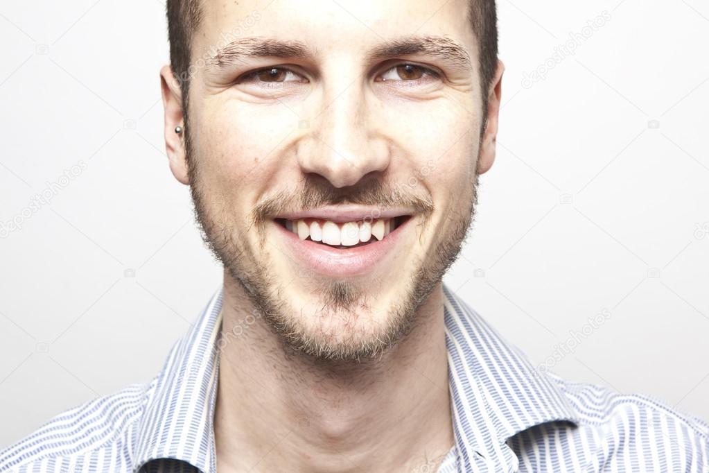 Homme Souriant visage du jeune homme, sourire — photographie tommasolizzul © #13764586
