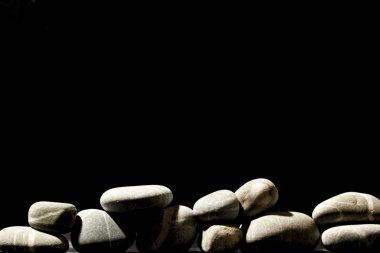 White stones on black background
