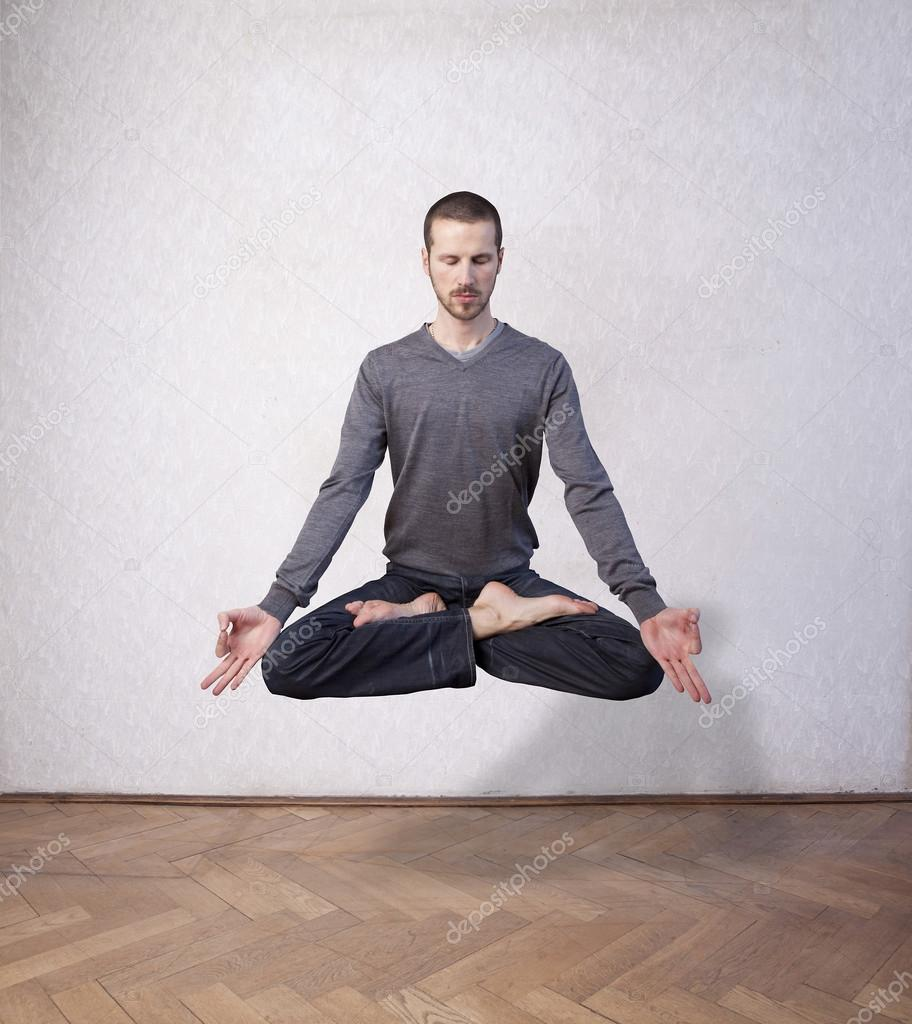 Young man levitating in yoga position, meditation — Stock Photo