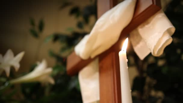 A candle near a cross in church at Easter.