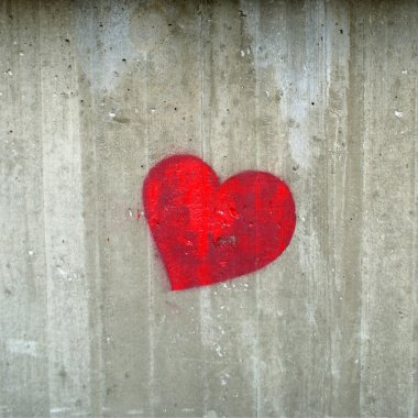 Red hearth on the concrete gray wall