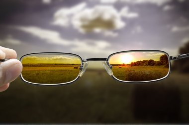 Seeing sunset through glasses