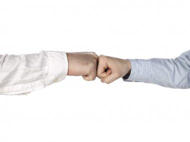 Two hands doing a fist bump