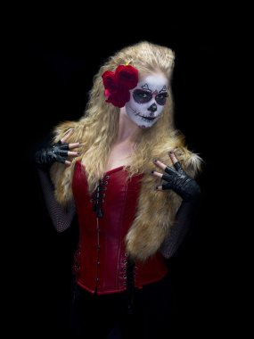 Female wearing scary make up posing with hands on shoulders