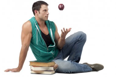 man throwing the apple while sitting