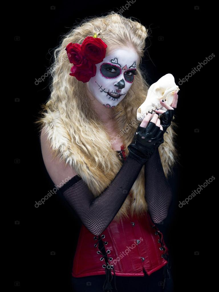 Portrait shot of a young woman wearing sugar skull make up