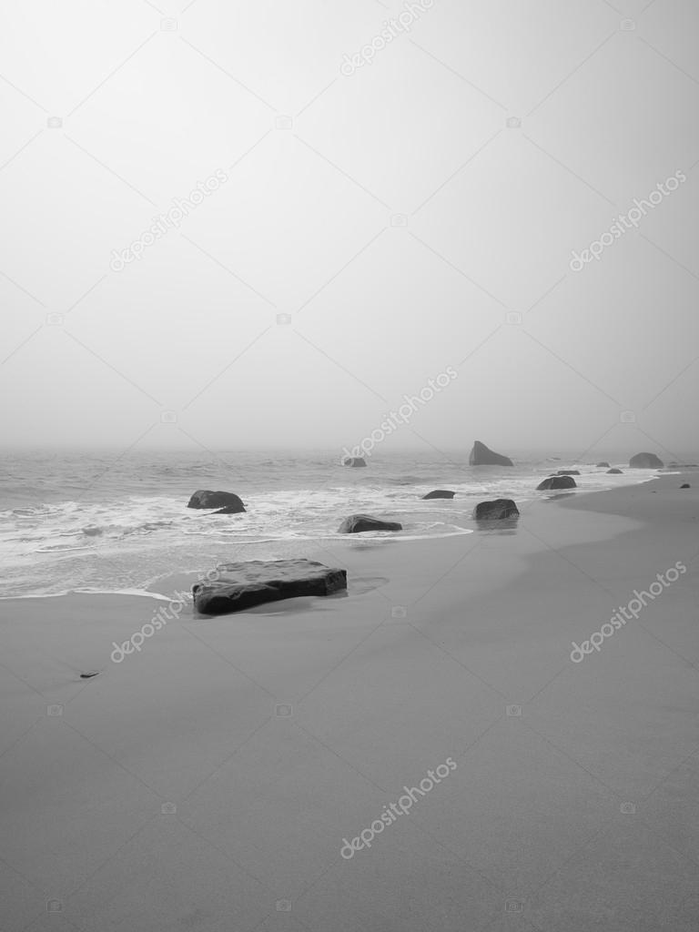 image of a tranquil beach with rocks