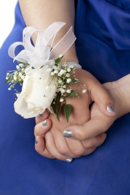 a lady in prom with wrist corsage