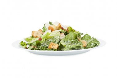 delicious ceasar salad in white plate