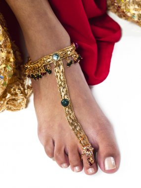 close up shot of a woman wearing gold anklet