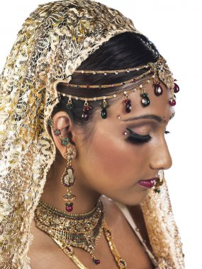 side view of a attractive female wearing bridal dress and jewelr