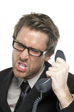 a stressed businessman answering call