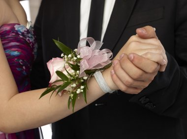 pink corsage in a woman wrist