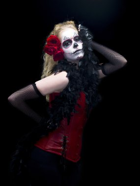 Portrait of a scary woman posing over dark background