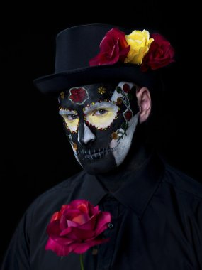portrait shot of a man with traditional sugar skull make up