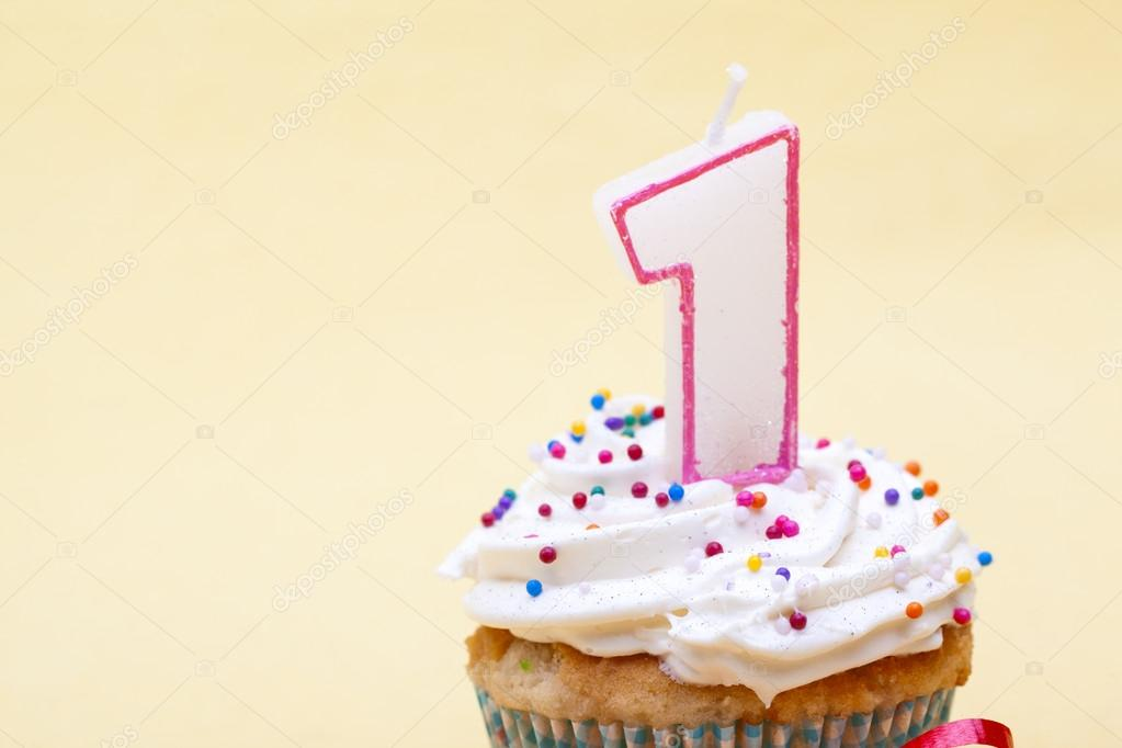 Cupcake With Birthday Candle Of One Year Old Isolated On Plain Background