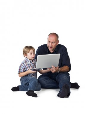 574 father and son sitting together and using laptop