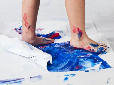 human foot printing color on piece of paper