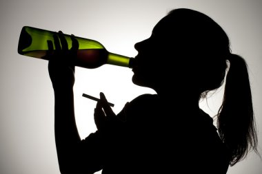 378 silhouette of woman drinking wine with cigarette