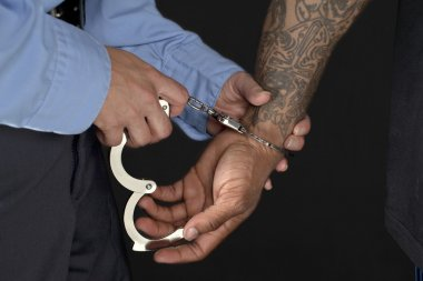 560 police officer handcuffing a man