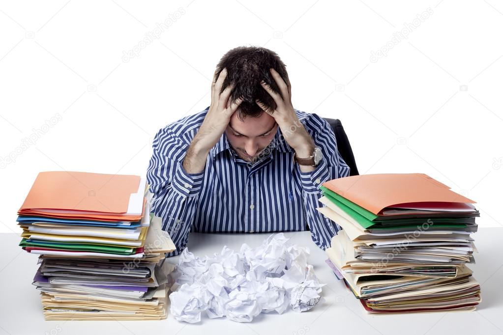 stressed businessman with head in hand
