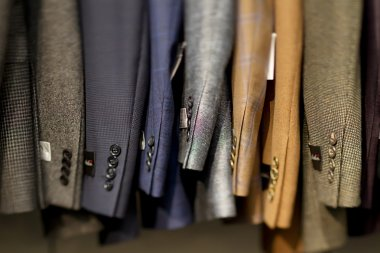 567 suits hanging in store
