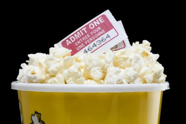 a bucket of popcorn with two cinema tickets