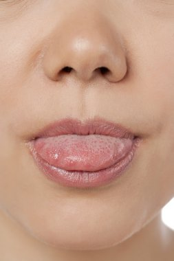a lady sticking out her tongue