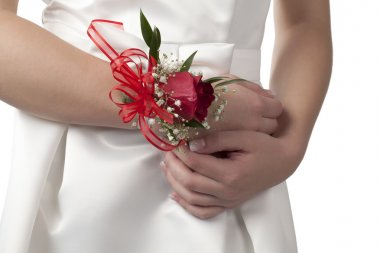 a lady with wrist corsage
