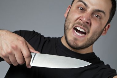 a male killer with a knife