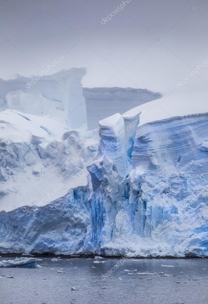 Antarctic Iceberg with glowing cracks