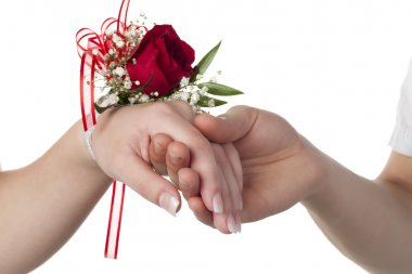 a lady with red rose corsage