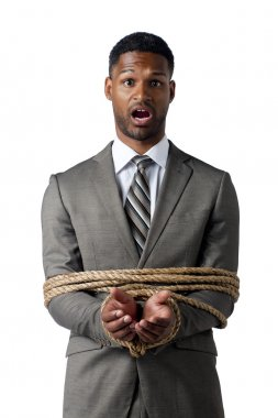 african american businessman wrapped in rope