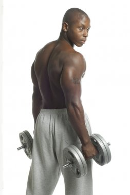 african american man with dumbbell looking at camera