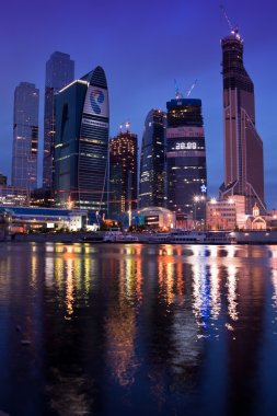 Business area Moscow City. Night view over the river.