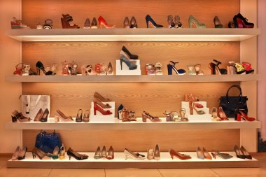 Shoes and bags on the shelves in the store