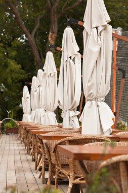 Summer restaurant terrace. End of the Season.