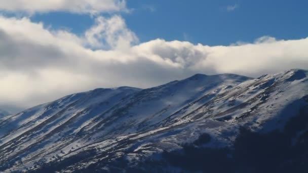 Clouds over mountain ridge