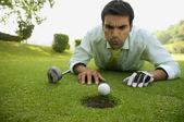 Fényképek ember, golf labda