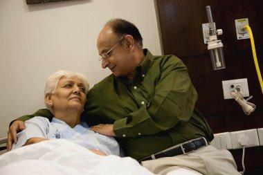 Man comforts wife