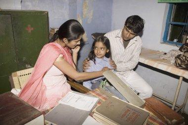doctor examines patient